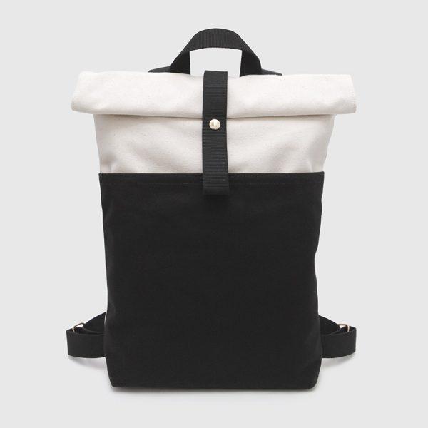 Nueva mochila nómada roll-top en crudo y negro
