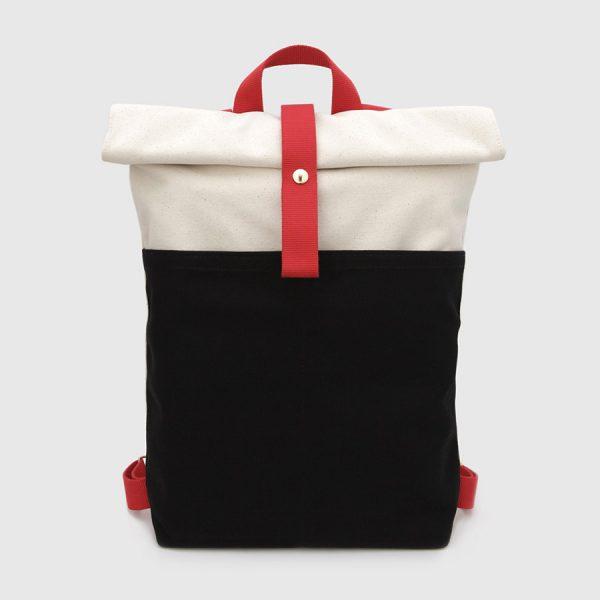 mochila nómada en crudo y negro con correas rojas