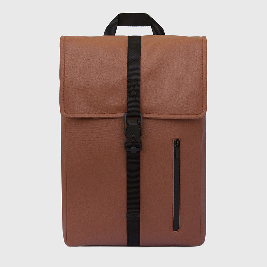 Waxed, padded and reinforced brown backpack.