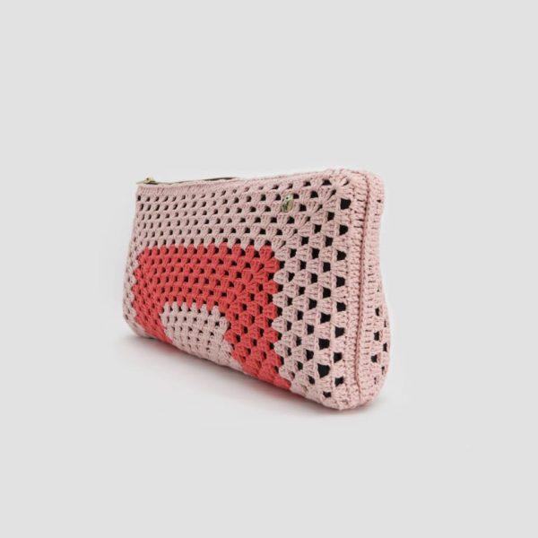 Bolso de mano rosa y coral
