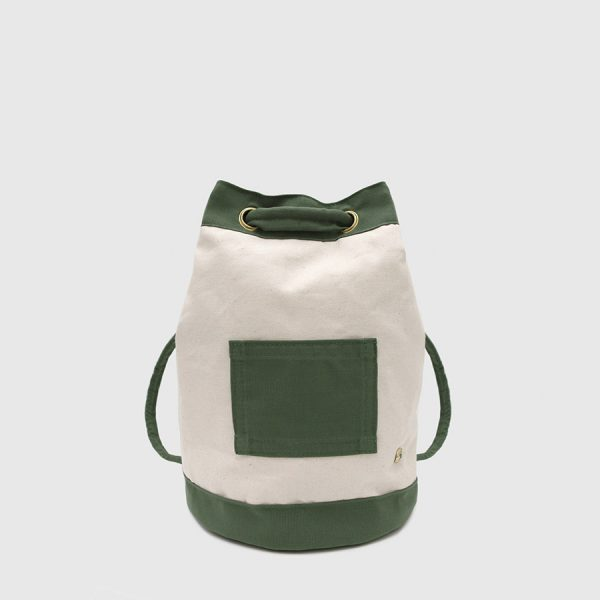 GREEN AND ECRU CANVAS BACKPACK. 1994 backpack