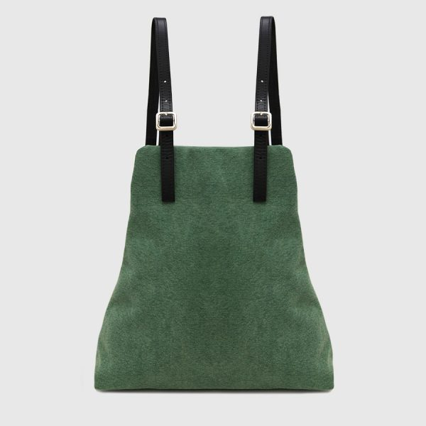 green canvas backpack and black leather