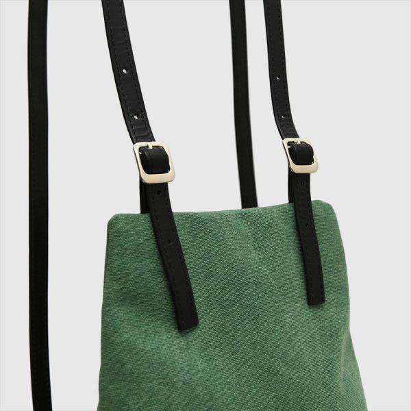 green backpack handles leather KOS