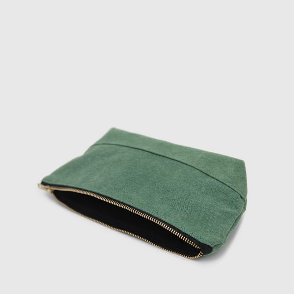 green canvas and interior black toilet bag
