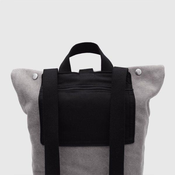 nomada gris bolsillo negro